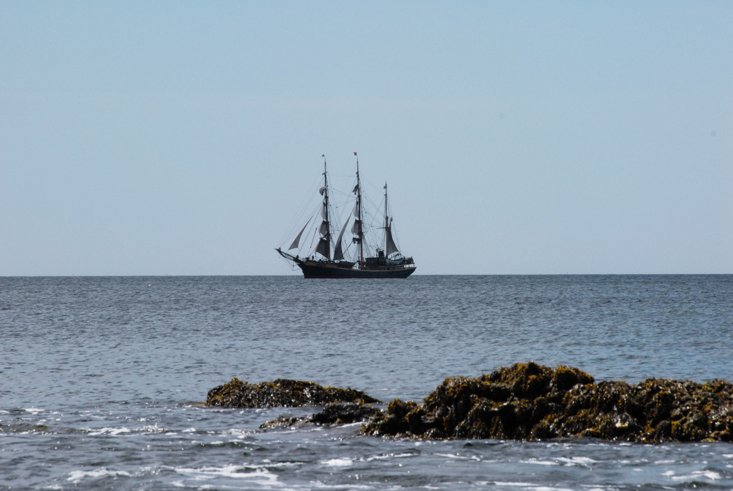 Tall ship with sails furled