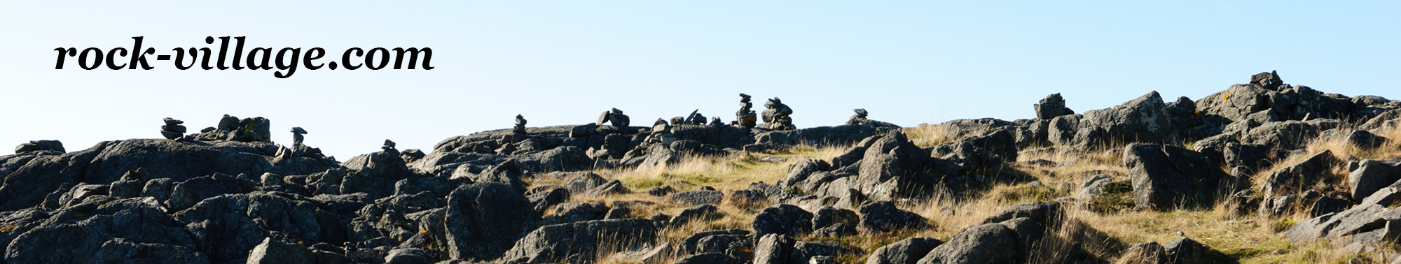 Rock Village Website banner picture, a rocky area with cairns